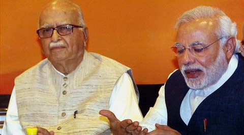 : BJP Prime Ministerial candidate Narendra Modi, and senior leader LK Advani during party's Central Election Committee (CEC) meeting in New Delhi on Thursday. (PTI Photo)