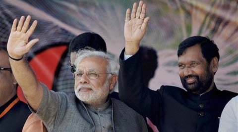 Muzaffarpur: BJP Prime Ministerial candidate Narendra Modi and LJP chief Ram Vilas Paswan wave at the crowd during the Hunkar rally in Muzaffarpur on Monday. (PTI photo)