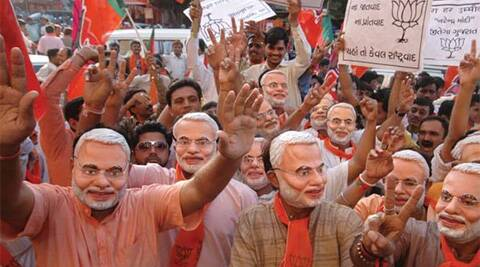 In this photo BJP members wear Narendra Modi masks during an election rally. (AP)
