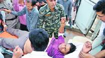 An injured policeman is being taken to hospital in Raipur on Friday.	(PTI)