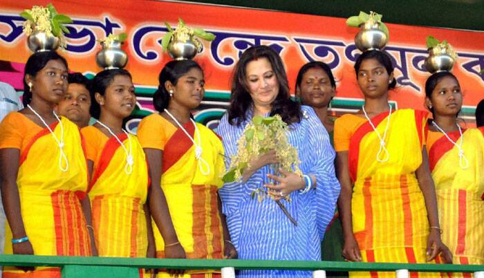 Actor and TMC candidate Moonmoon Sen with Tribals at Bankura in West Bengal on Sunday during her party workers convention as a part of her Election campaign for the Loka sabha Poll.  (PTI)