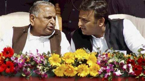"Samajwadi Party supremo Mulayam Singh Yadav and UP CM Akhilesh Yadav during closing ceremony of the party's ""Desh Banao Desh Bachao"" cycle rally in Lucknow on Thursday. (PTI Photo)"