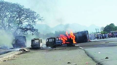 The charred remains of the vehicles at the accident site on Ahmedabad-Mumbai national highway on Saturday. 	express