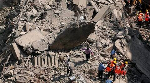 Rescue workers search for survivors in the debris of a building that collapsed in Mumbai. (AP)