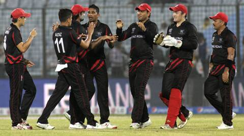 Munir Dar (extreme right) celebrates with fellow team mates after the dismissal of an Afghanistan batsman. (AP)