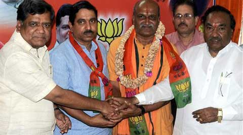 Pramod Muthalik joining BJP in presence of former CM Jagadish Shettar in Hubli on Sunday. (PTI Photo)