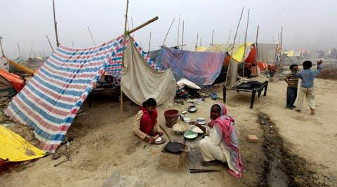 A refugee family at a Relief camp at Village Malakpur in Shamli district post the Muzaffarnagar riots. (Express Archive)