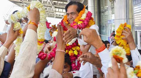 Congress candidate Namo Narain Meena from Sawai Madhopur is welcomed on his arrival in Jaipur on Tuesday. (PTI Photo)