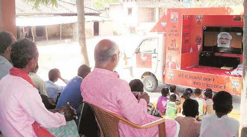 The rath at Ekla Purva in Siswa village. As the 10-minute Modi video plays, partymen distribute pamphlets, masks. (Express Photo: Lalmani Verma)