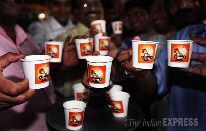BJP workers continue distributing Tea (NaMo Chai) at Dharavi to campaign for Gujarat Chief Minister and Bharatiya Janata Party's prime ministerial candidate Narendra Modi in Mumbai. (IE Photo: Pradip Das)