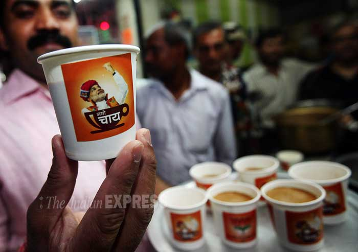 A vendor shows NaMo Chai cup. (IE Photo: Pradip Das)