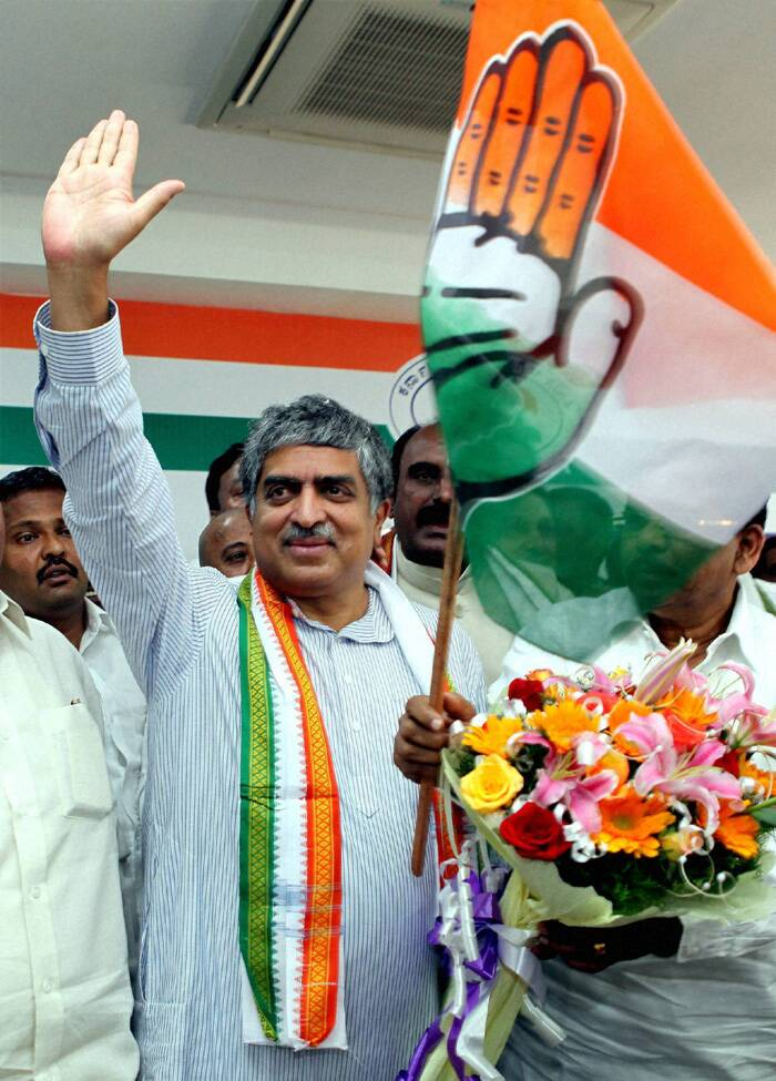 Amid drumbeats, Nilekani, Chairman of the Unique Identification Authority of India, was welcomed into Congress by KPCC President G Parameshwara who handed over the party flag to him before he filled in the membership form at a function at party office. (PTI)