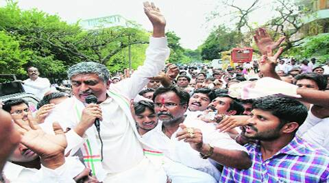 Congress candidate from Bangalore South constituency Nandan Nilekani addresses supporters after filing his nomination papers in Bangalore Friday. (PTI)