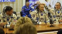 American, two Russians back on Earth after half-year inspace