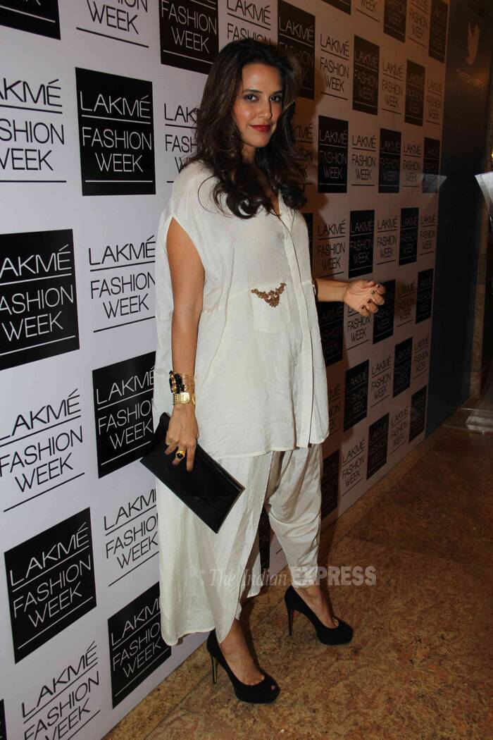 Actress Neha Dhupia scored high on our style-metre with her white shirt-kurta and dhoti style pants by Nupur Kanoi. She finished off her look with black pencil heels and clutch. (Photo: Varinder Chawla)