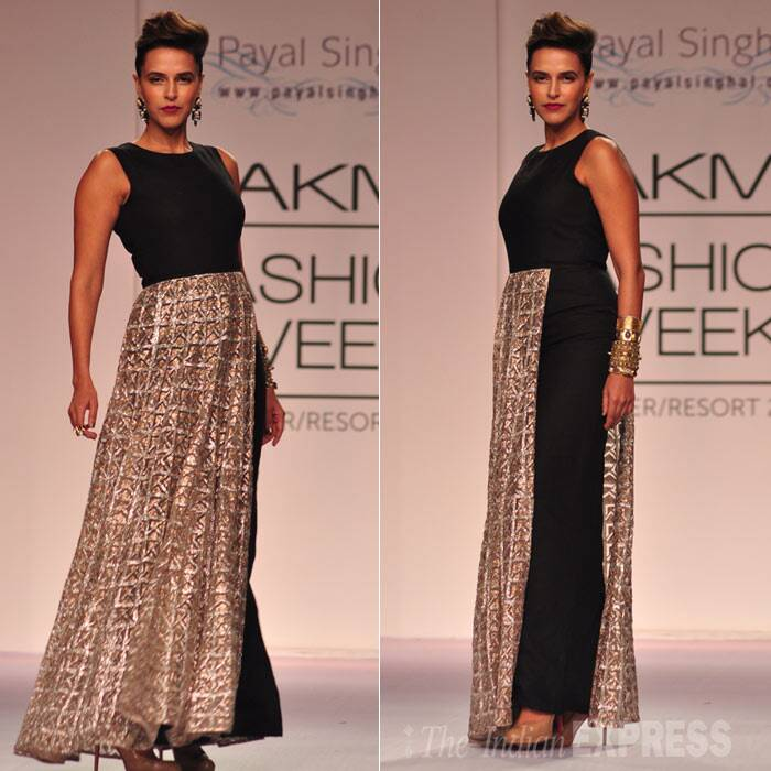 Bollywood actress Neha Dhupia was an absolute beauty as she walked down the ramp in a black and bronze creation on Day 3 of the ongoing Lakme Fashion Week Summer/Resort 2014.  (Photo: Varinder Chawla)
