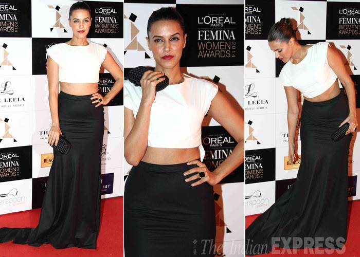 Former Miss India and Bollywood actress Neha Dhupia may not be making waves on the big screen but she is definitely a hit off it. She looked amazing in a white DRVV crop top with black Ashish N Soni skirt. She tied her hair in a neat tight bun and added a pop of colour with her red lipstick. (Photo: Varinder Chawla)