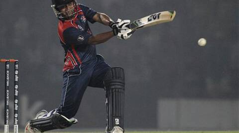 Nepal's Gyanendra Malla plays a shot during a warm-up cricket match against Ireland ahead of the Twenty20 World Cup Cricket in Fatullah, near Dhaka, Bangladesh, Wednesday, March 12, 2014. (AP Photo)