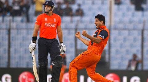 Netherlands's Mudassar Bukhari, right, celebrates the wicket of England's Michael Lumb, left, during their ICC Twenty20 Cricket World Cup match in Chittagong (AP)