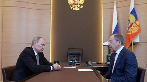 Russian President Vladimir Putin, left listens to Foreign Minister Sergey Lavrov, right, during their meeting at the Bocharov Ruchei residence in Sochi, southern Russia. (AP)