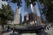 Visitors look at panels containing the names of the victims of the attacks at at the World Trade Center site in New York, September 12, 2011. (Reuters)