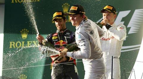 Nico Rosberg of Germany (C) sprays champagne beside second-placed Red Bull Formula One driver Daniel Ricciardo of Australia (L) and third-placed McLaren Formula One driver Kevin Magnussen of Denmark after the Australian F1 Grand Prix (Reuters)