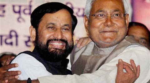 Bihar Chief Minister Nitish Kumar welcomes former Union Minister and Samajwadi Janata Dal (Democratic) Chief Devendra Prasad Yadav he joined JDU party at Rabindra Bhawan in Patna on Sunday. (PTI photo)