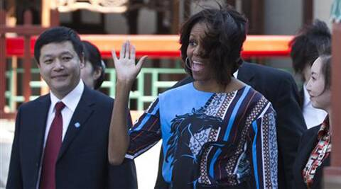 Michelle Obama waves to a group of schoolchildren in Beijing. (AP)