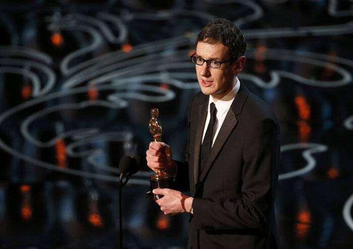 "Steven Price accepts the Oscar for original score for ""Gravity"" at the 86th Academy Awards in Hollywood, California. (Reuters)"