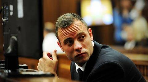 Oscar Pistorius glances sideways as he listens to ballistic evidence being given in court in Pretoria, South Africa (AP)