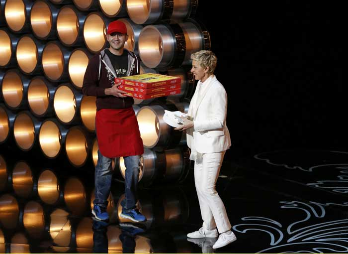 Making way for light-hearted laughs amidst sophisticated clip montages and lavish song-and-dance productions, DeGeneres also brought in pizza for the attendees, showcasing her flair for comedy. (AP)