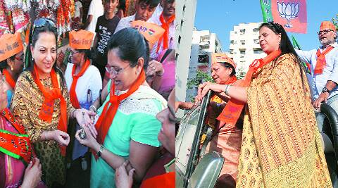 BJP party workers apply lotus-shaped mehndi on the palm of BJP patriarch L K Advani's daughter Pratibha Advani, as she canvasses for her father at Gandhinagar constituency on Friday; (Right) Pratibha Advani along with minister Anandi Patel on the campaign trail in Ahmedabad on Friday. javed raja