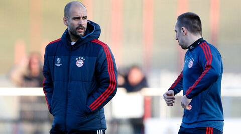 Bayern head coach Pep Guardiola of Spain, left, talks to Franck Ribery of France during during a training session in Munich (AP)