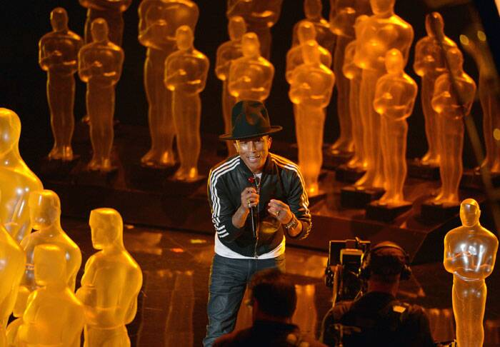 Pharrell Williams performs 'Happy' at the illuminated Oscars sttage. (AP)