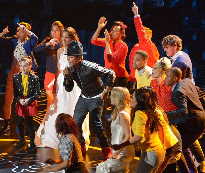 Pharrell Williams, center, performs 'Happy' along with other artists. (AP)