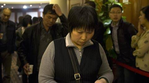 Chinese relatives of passengers aboard a missing Malaysia Airlines plane walk out from a hotel room after attending a briefing by Malaysia Airlines in Beijing, China Sunday, March 16, 2014. Attention focused Sunday on the pilots of the missing Malaysia Airlines flight after the country's leader announced findings so far that suggest someone with intimate knowledge of the Boeing 777's cockpit seized control of the plane and sent it off-course. (AP)