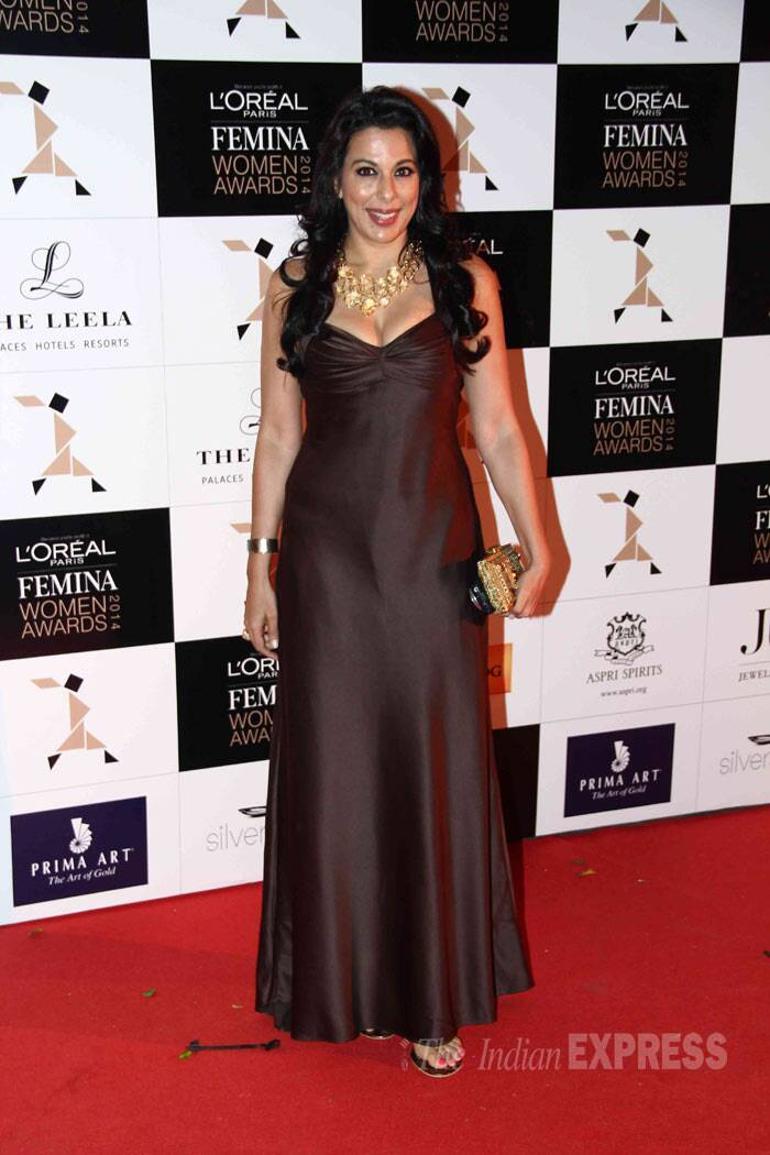 Former actress Pooja Bedi stepped out in a dark bown gown with gold jewellery. (Photo: Varinder Chawla)