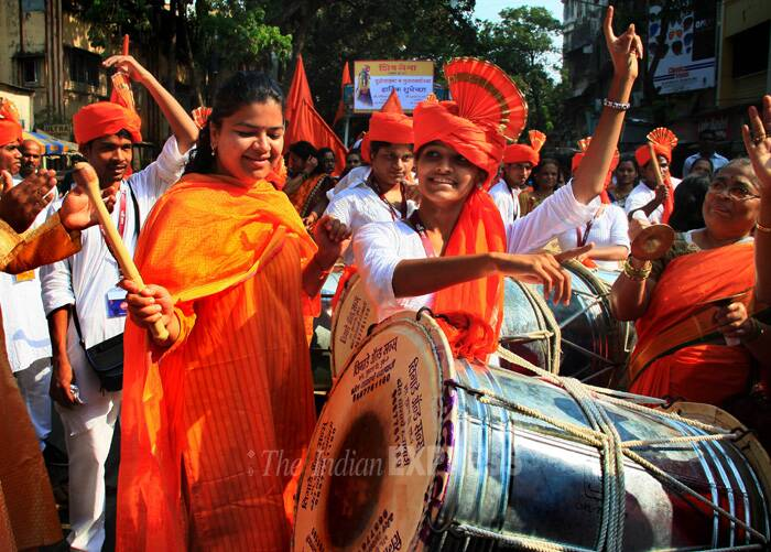 Poonam Mahajan tries her luck with the dhol at the procession. (IE Photo: Amit Chakravarty)