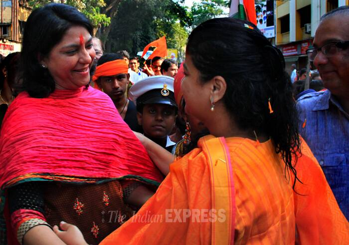 Putting aside their political allegiances BJP's Poonam Mahajan and Congress' Priya Dutt were seen celebrating the Gudi Padwa festival in Mumbai. (IE Photo: Amit Chakravarty)
