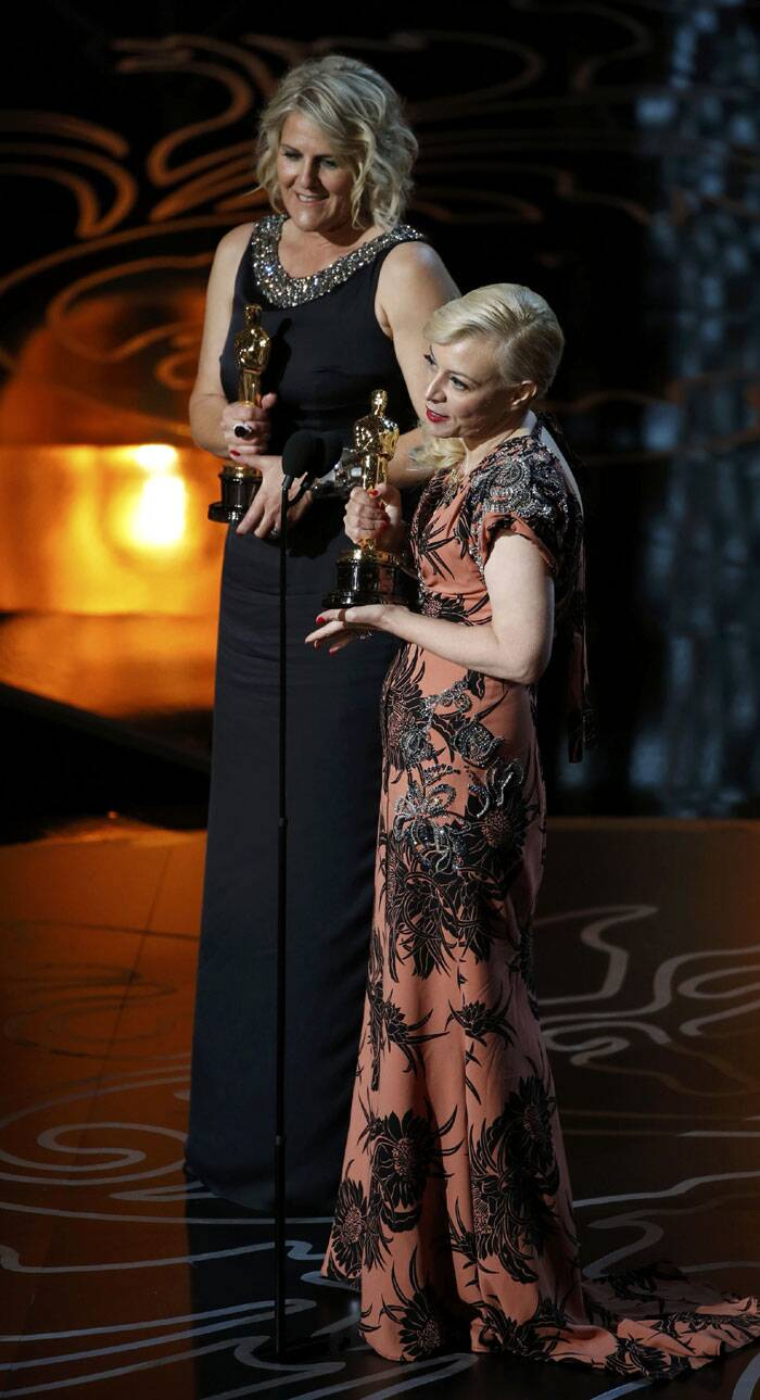 "Catherine Martin (R) accepts the Oscar for production design and Beverley Dunn accepts for set decoration for ""The Great Gatsby"" at the 86th Academy Awards in Hollywood, California. (Reuters)"