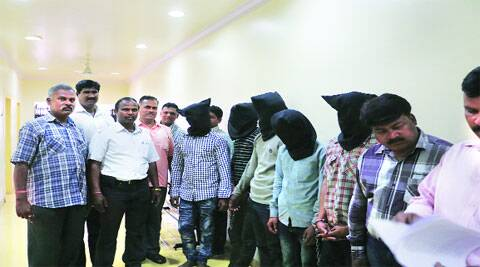 Crime branch officers with the suspects at the police commissionerate on Wednesday; (right) the recovered booty. (Pranav Singh)