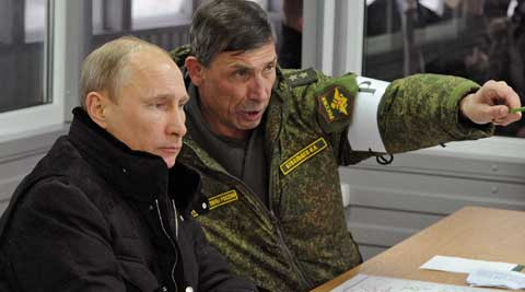 Russian President Vladimir Putin on Tuesday told troops to return to their permanent bases. (AP Photo)
