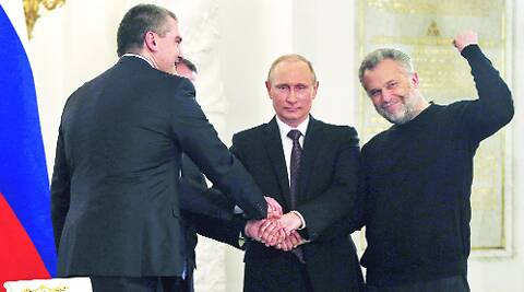 Putin with three top leaders of Crimea after signing the annexation treaty at the Kremlin on Tuesday. REUTERS
