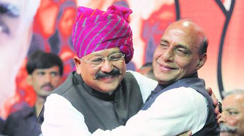 BJP chief Rajnath Singh with Satpal Maharaj at the BJP office in Delhi Friday.  Anil Sharma