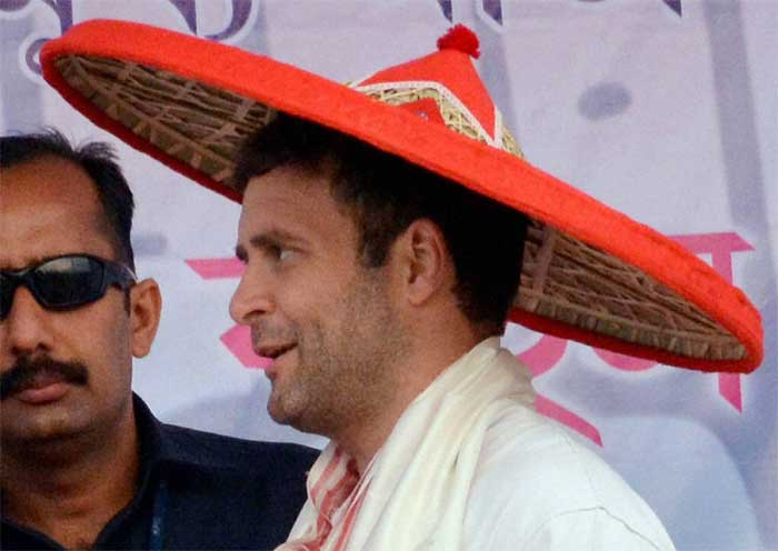 "Congress Vice President Rahul Gandhi being felicitated with an Assamese traditional ""Japi"" at an election rally at Biswanath Charali in Sonitpur district. (PTI Photo)"