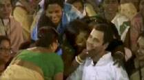 Rahul Gandhi being planted a kiss by a woman