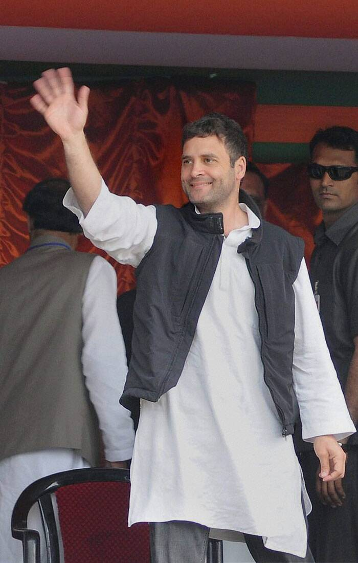 "Rahul Gandhi today accused BJP of unleashing the ""politics of anger"" before elections by pitting Hindus against Muslims and the rich against poor and said the 'Gujarat model' cannot be imposed on the country. <br /> Rahul Gandhi waves to party workers at Biswanath Chariali in Sonitpur district on Thursday. (PTI)"