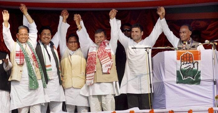 Congress Vice President Rahul Gandhi raises hands along with Assam Chief Minister Tarun Gogoi and other party leaders at an election rally at Biswanath Chariali in Sonitpur district on Thursday. (PTI)