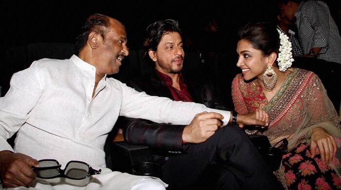 Deepika Padukone will be romancing Rajinikanth in the movie. Soundarya had revealed that Rajinikanth felt awkward whole doing romantic scenes with the 'Chennai Express' starlet.<br /> Rajinikanth shares a joke with Deepika and Shah Rukh Khan. (PTI)