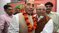 Lalji Tandon gets a hug from Rajnath Singh in Lucknow Wednesday. (Vishal Srivastav)